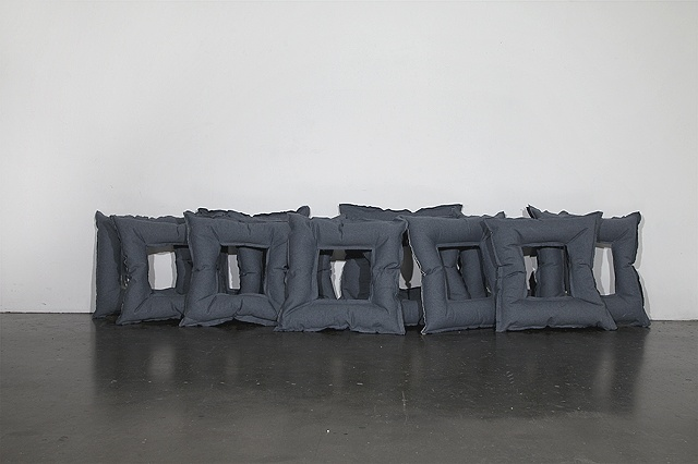 Denim suqares filled with spray foam by Missy Engelhardt
