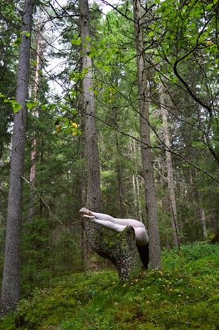 photograph of woman white stockings green forest Sweden by Robyn LeRoy-Evans
