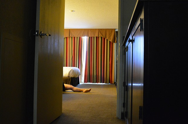 photograph of woman leg hotel room bed curtains drapery window by Robyn LeRoy-Evans