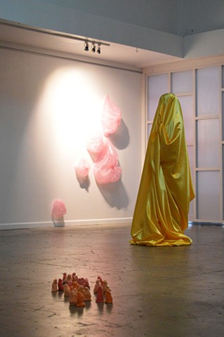 live performance yellow satin figure by Robyn LeRoy-Evans