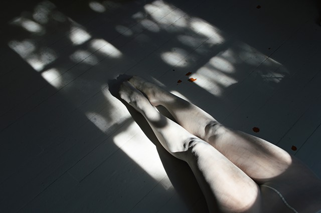 photograph of woman white stockings floorboards dappled sunlight by Robyn LeRoy-Evans