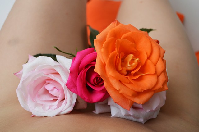 photograph of woman body bouquet roses red pink orange bruise by Robyn LeRoy-Evans