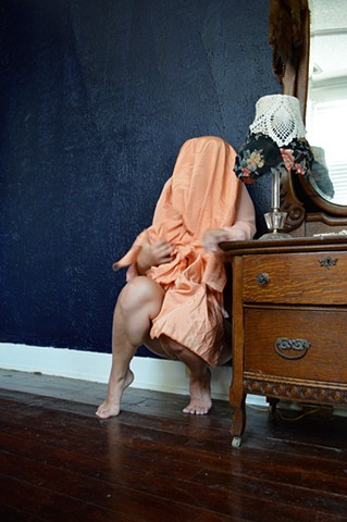 photograph of woman veiled shroud trembling afraid interior by Robyn LeRoy-Evans