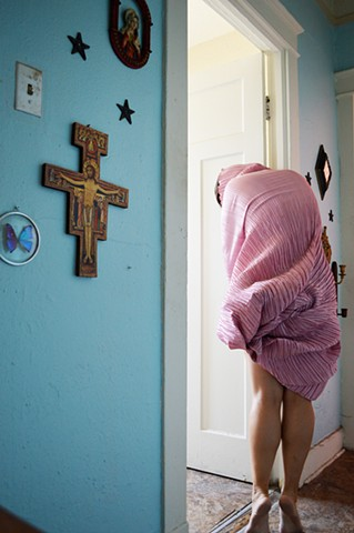 photograph of woman pink drapery cross jesus crucifix hallway interior New Orleans by Robyn LeRoy-Evans