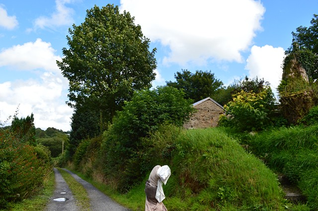 photograph of woman white cream dress trees blue sky in Wales by Robyn LeRoy-Evans