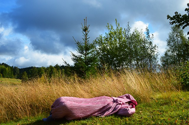surreal photograph of headless woman pink dress landscape sky Sweden by Robyn LeRoy-Evans