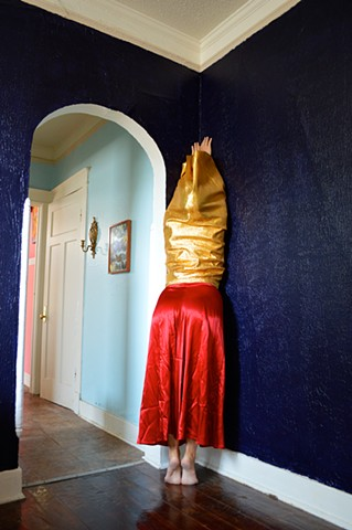 photograph of woman gold red clothing faceless figure house New Orleans by Robyn LeRoy-Evans