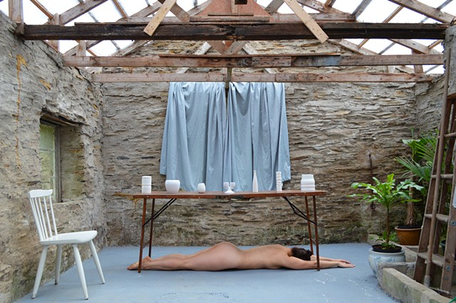 photograph of nude woman drapery vessel chair stone building curtains Wales by Robyn LeRoy-Evans