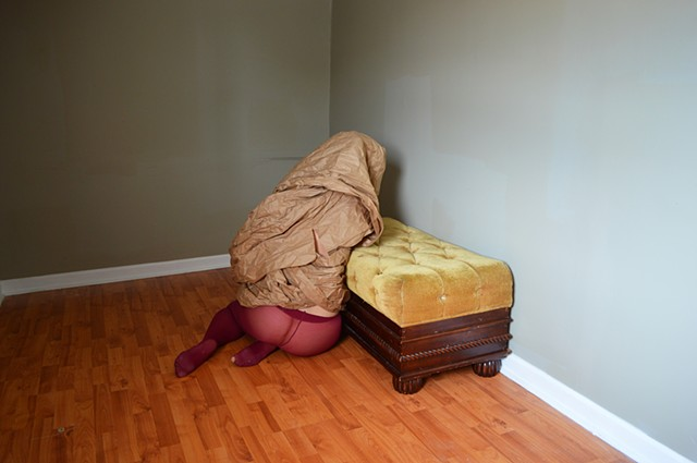 photograph of woman red tights brown paper studio by Robyn LeRoy-Evans