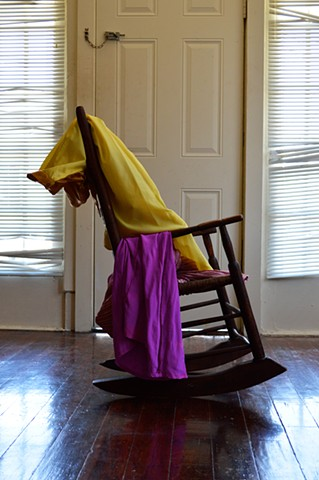 photograph of rocking chair door blinds woman clothing by Robyn LeRoy-Evans