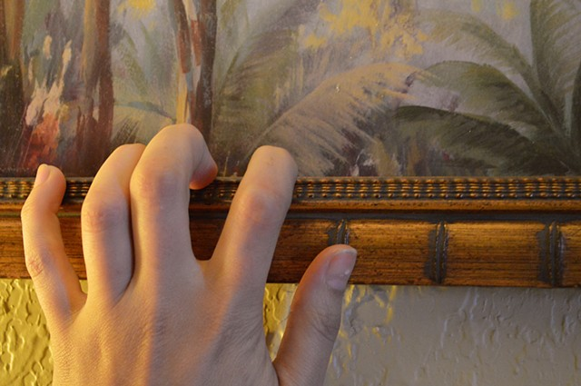 photograph of hand fingers painting picture frame palm leaves by Robyn LeRoy-Evans