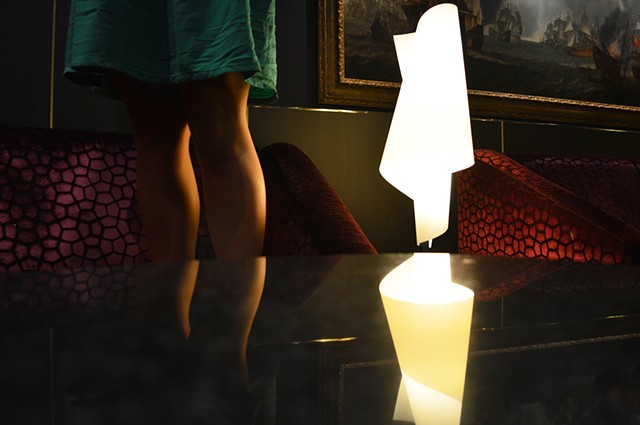 photograph of woman legs table lamp lounge cruise ship by Robyn LeRoy-Evans