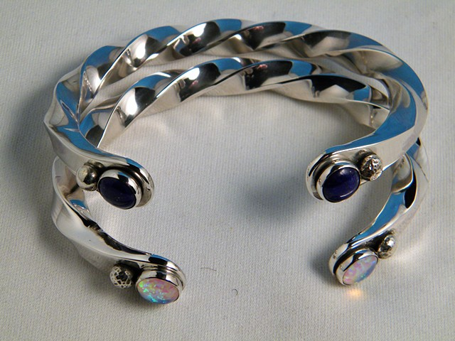 Twisted silver cuffs with lapis and opal