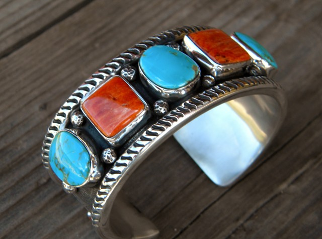 Spiney oyster shell and turquoise cuff with sponge coral.