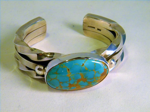 Twisted silver and turquoise cuff.