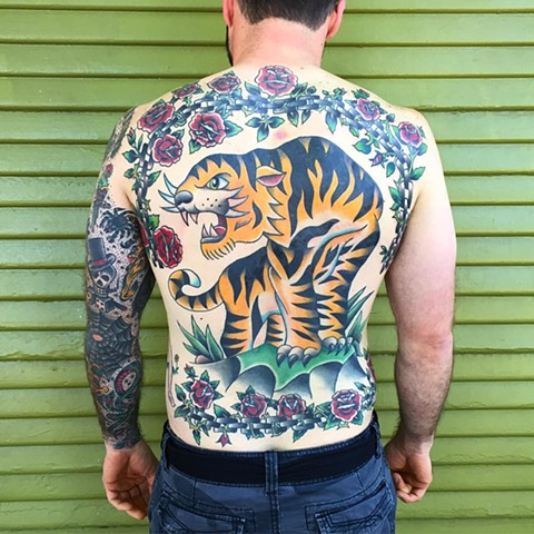 Traditional tiger back piece tattoo made at historic tattoo by Brad Delay