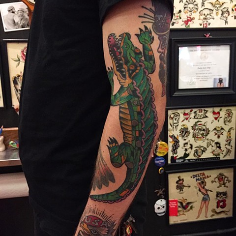 Traditional alligator tattoo by Brad Delay