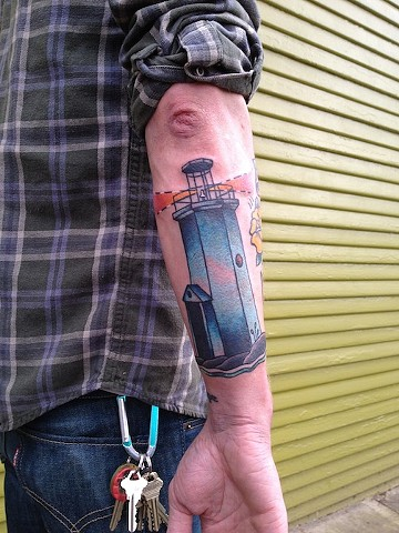 lighthouse tattoo by Bradley Delay