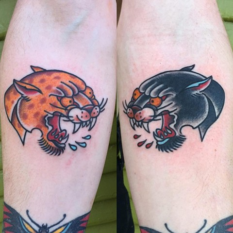 Tiger and panther tattoo by Brad Delay