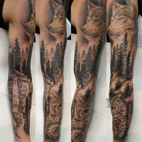 wilderness sleeve in black and grey tattoo strange world tattoo calgary alberta