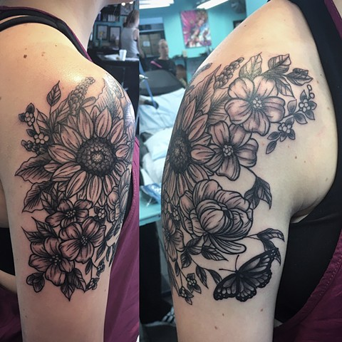 black and grey flower tattoo at Strange World Tattoo in Calgary, Alberta