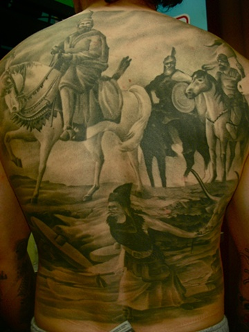 Black and grey backpiece tattoo