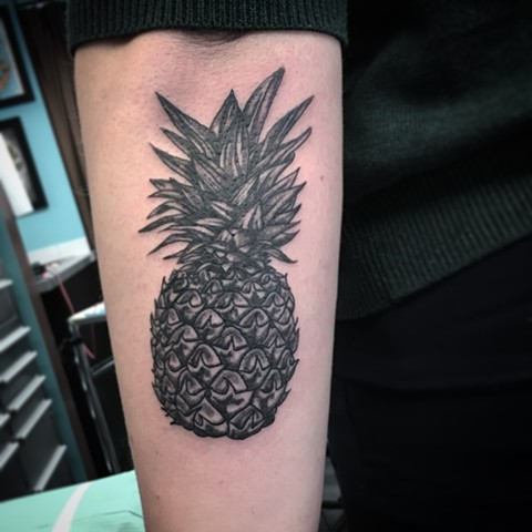 pineapple tattoo at strange world tattoo in calgary