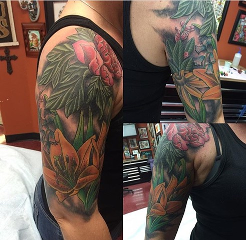 botanical half sleeve tattoo in colour Strange World Tattoo Calgary,Alberta Canada