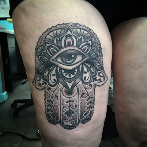 Hamsa hand tattoo strange world tattoo