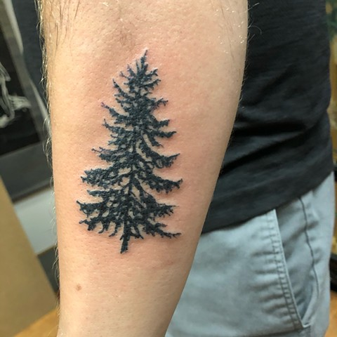 black tree on forearm