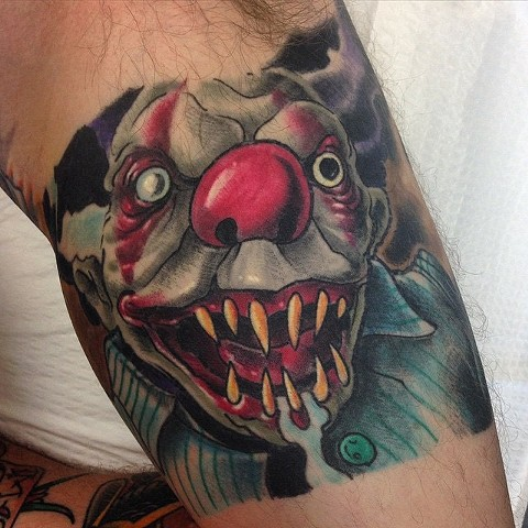 Creepy, evil clown tattoo by Brett Schwindt of Strange World Tattoo