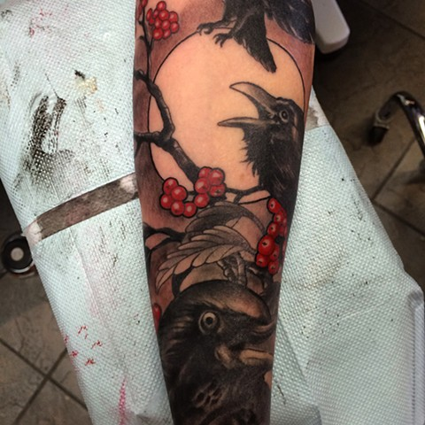 full arm sleeve of black crows, branches and red berries by tattoo artist Brett Schwindt of Strange World Tattoo in Calgary