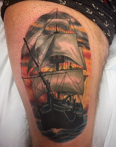 Colour pirate ship tattoo on upper thigh by tattoo artist Brett Schwindt
