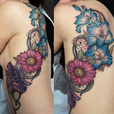 rib-cage tattoo of gorgeous lace and flowers at strange world tattoo in calgary, alberta