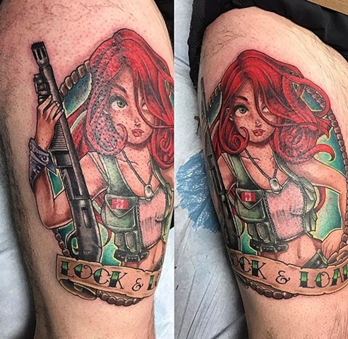 redheaded girl with a gun tattoo on upper thigh Strange World Tattoo Calgary, Alberta Canada