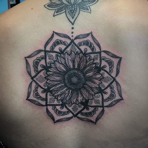 mandala tattoo at strange world tattoo