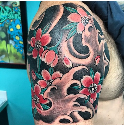 Japanese cherry blossom tattoo with waves strange world tattoo calgary canada tattoo artist's calgary