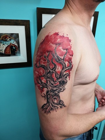 black and grey tree tattoo with water colour strange world tattoo calgary