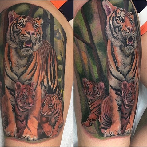 Tiger tattoo in colour on upper thigh Strange World Tattoo Calgary Canada