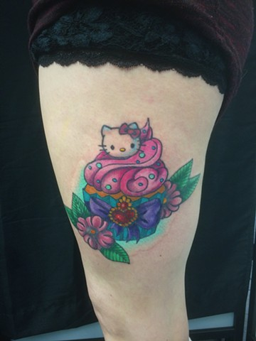 hello kitty tattoo strange world tattoo calgary