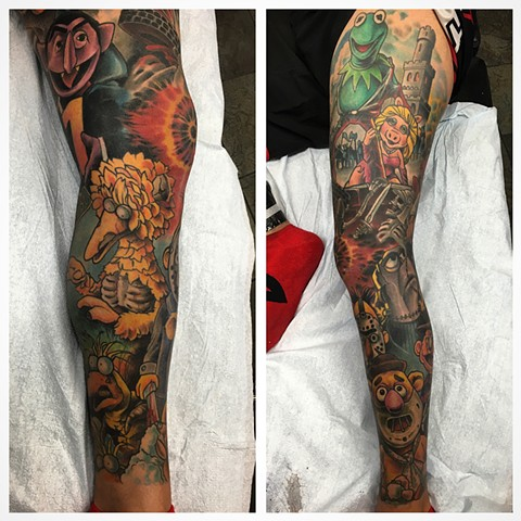 Full leg sleeve tattoo of The Muppet's as iconic Horror Movie characters by Brett Schwindt at Strange World Tattoo