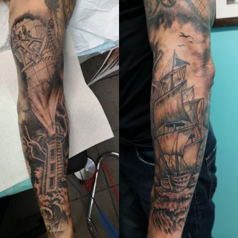nautical theme tattoo sleeve with lighthouse and ship in black and grey strange world tattoo calgary