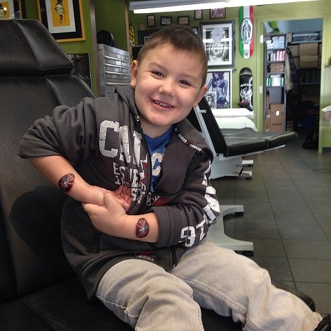 kids of our tattoo and piercing clients at Strange World Tattoo in Calgary