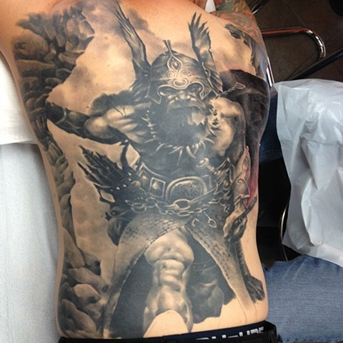 Black and grey viking backpiece tattoo