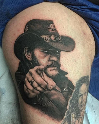 Lemmy tattoo in black and grey on upper thigh Strange World Tattoo Calgary, Alberta