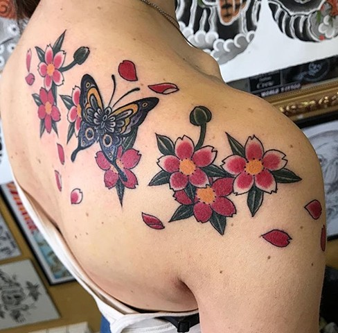 butterfly tattoo flower tattoo strange world tattoo calgary alberta canada colour tattoo