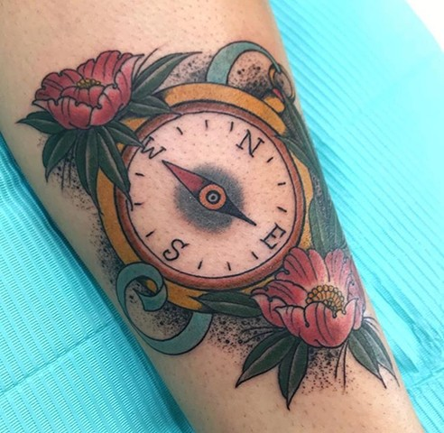 compass with flower tattoo in bright, bold colour Strange World Tattoo Calgary Alberta Canada