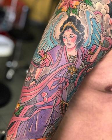 Japanese half sleeve tattoo in colour on upper arm Strange World Tattoo Calgary Alberta Canada