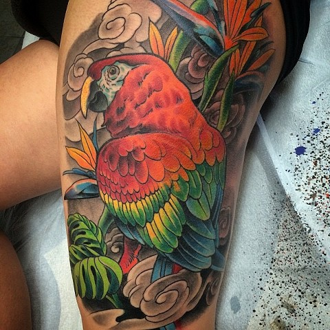 Tattoo of parrot tropical theme