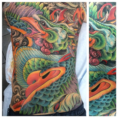 full back piece tattoo of a phoenix design by the talented Brett Schwindt of Strange World Tattoo in Calgary